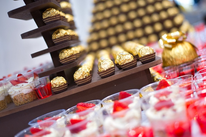 Ferrero Rocher and strawberry cheesecake dessert table at wedding
