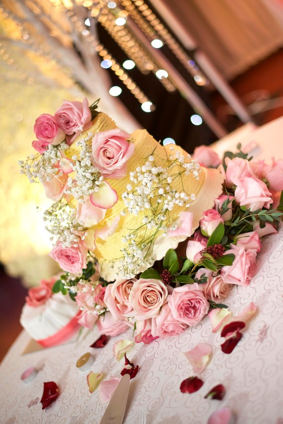 Pink roses and white flower wedding cake