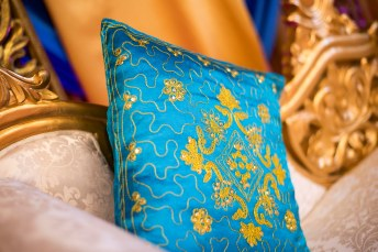 Blue and gold cushion on a wedding stage