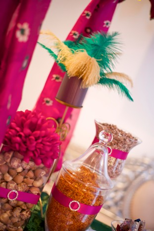 Purple and pink wedding decoration jars filled with exotic spices