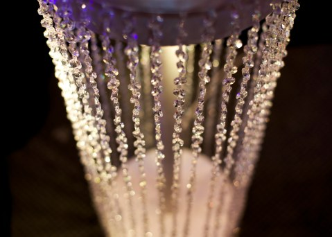 Crystal stage lighting feature at a wedding venue