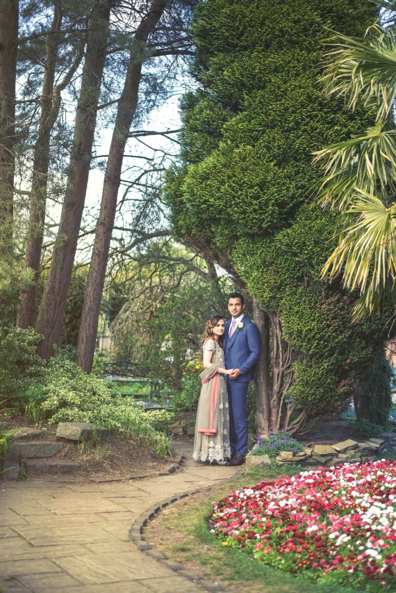 Bride and groom posing in the Stockwood Discovery gardens