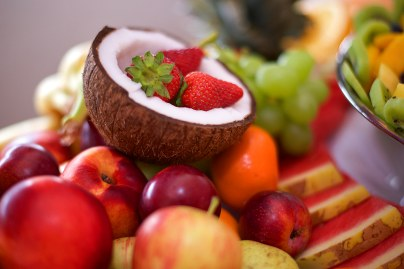 Coconut, strawberries, grapes, apples and melons at a wedding