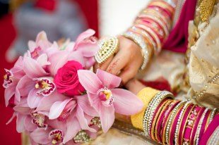 Pink rose and flower wedding bouquet with asian bangles