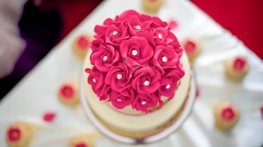 Wedding cake made with homemade sugar silver diamond studded roses