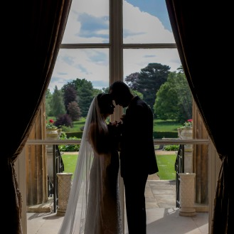 Silhouette of bride and groom on their wedding day inside the Luton Hoo Hotel