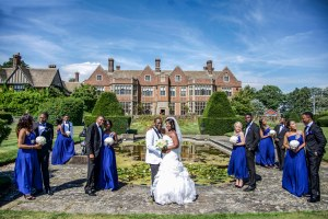 Bride and Groom with groomsmen and bridesmaids on their Wedding day at Putteridge Bury Sarah Slimani Photography